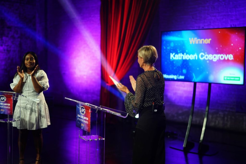 Shows a photo from the LALYs studio when Kathy won the Housing Law award.